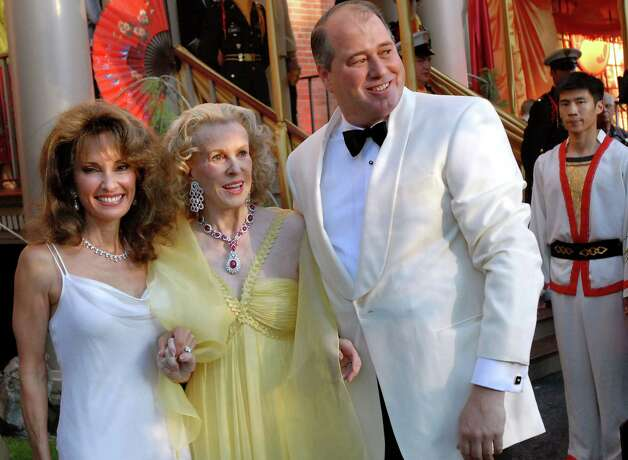"Susan Lucci, Marylou Whitney and John Hendrickson pose for pictures at the gala ""A Night in Hong Kong"" on Friday, Aug. 1, 2008, at the Canfield Casino in Saratoga Springs, N.Y. (Cindy Schultz/Times Union archive) Photo: CINDY SCHULTZ / ALBANY TIMES UNION"