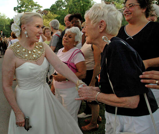 "Alice Myers of Saratoga Springs, right, thanks Marylou Whitney, left, ""for all she's done for the city"" during the Whitney Gala on Friday, Aug. 5, 2005, at Congress Park in Saratoga Springs, N.Y. The theme of this year's gala is ""A Night in Egypt."" (Cindy Schultz/Times Union archive) Photo: CINDY SCHULTZ / ALBANY TIMES UNION"