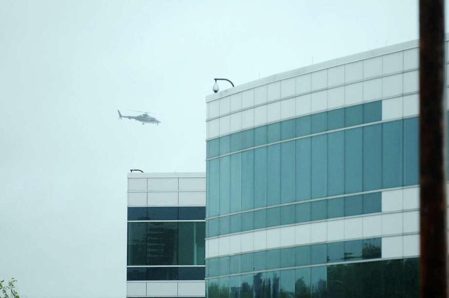 A helicopter circles over  the  College of Nanoscale Science and Engineering on the campus of the University at Albany prior to President Obama arriving on Tuesday morning, May 8, 2012 in Albany, NY.  (Paul Buckowski / Times Union) Photo: Paul Buckowski