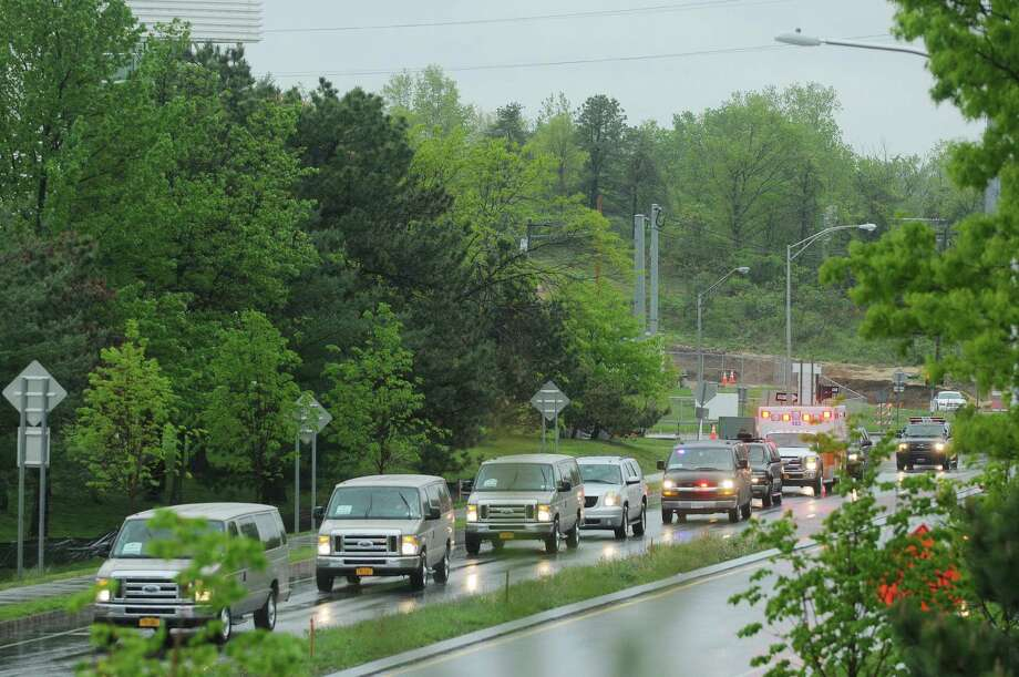 The support vehicles that make up the presidential motorcade head down Tricentennial Drive on their way to the  College of Nanoscale Science and Engineering on the campus of the University at Albany on Tuesday morning, May 8, 2012 in Albany, NY.  (Paul Buckowski / Times Union) Photo: Paul Buckowski