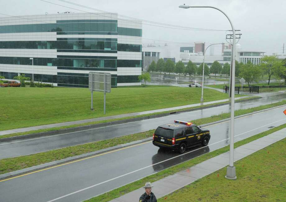 New York State Troopers provide security along Fuller Road at the  College of Nanoscale Science and Engineering on the campus of the University at Albany as they await the arrival of President Obama on Tuesday morning, May 8, 2012 in Albany, NY.  (Paul Buckowski / Times Union) Photo: Paul Buckowski
