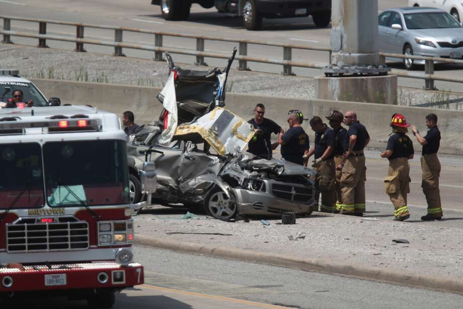 A single-car crash just before noon Tuesday in the southbound lanes of the Southwest  Freeway near Texas 288 snarled traffic. Officials said the driver apparently lost control and  flipped over several times. Photo: Johnny Hanson, Houston Chronicle