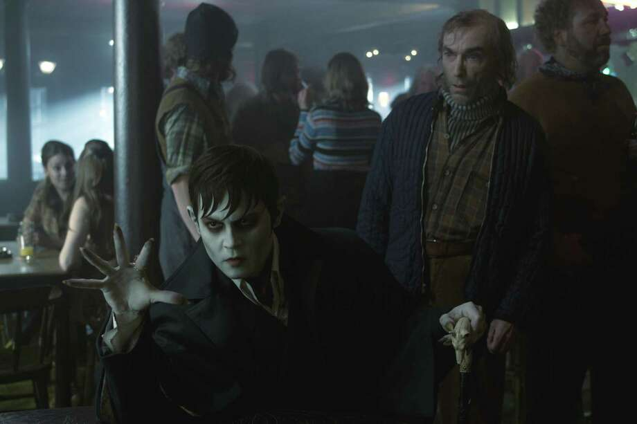 "Johnny Depp, left, stars as Barnabas Collins and Jackie Earle Haley as Willie Loomis in ""Dark Shadows."" Photo: Warner Bros. Pictures / © 2012 Warner Bros. Entertainment Inc. - U.S., Canada, Bahamas & Bermuda. © 2012 Village Roadshow Films (BVI) Limited ñ All othe"