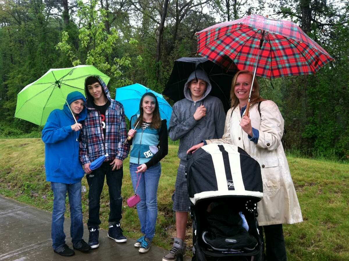 Keri Young of Altamont, right, took her teenagers out of school and pushed her 9-month-old son, Isaac, in a carriage to see President Obama arrive at the University at Albany on May 12, 2012.