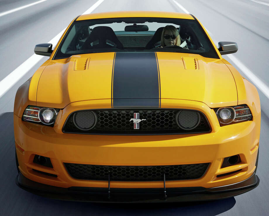 2013 Mustang Boss 302 Laguna Seca: The front end on the 2013 Mustang Boss 302 offers a more prominent grille. A new splitter and functional hood extractors add to that look. Boss Mustang has new signature lighting, with standard HID headlamps and LED-surround taillamps. (11/15/2011) Photo: Ford, Courtesy Of Ford Motor Co. / © 2011 Ford Motor Company