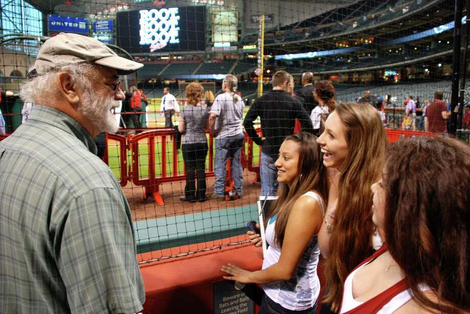 Professor Ron Heckleman catches up with students Erica Perez and Kelsey Kemper during batting practice. The Culture of Baseball class took a recent tour of Minute Maid Park and stayed to watch the game. Photo: Lindsay Peyton