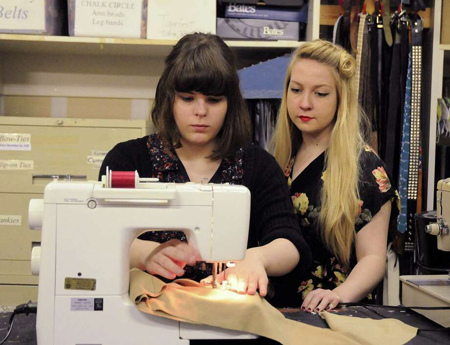 Katilin Newman watches as fellow theater arts student Sydney Elias sews on an original costume she designed during the Theater Arts class at The Woodlands High School. Photo: David Hopper / freelance