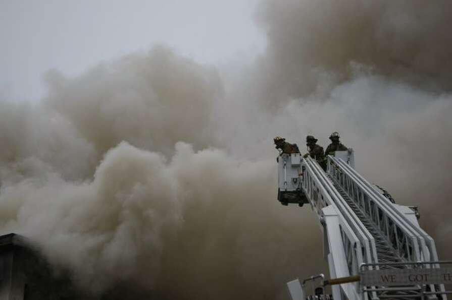 Firefighters battled a large fire at an abandoned strip center in north Houston Tuesday afternoon. (