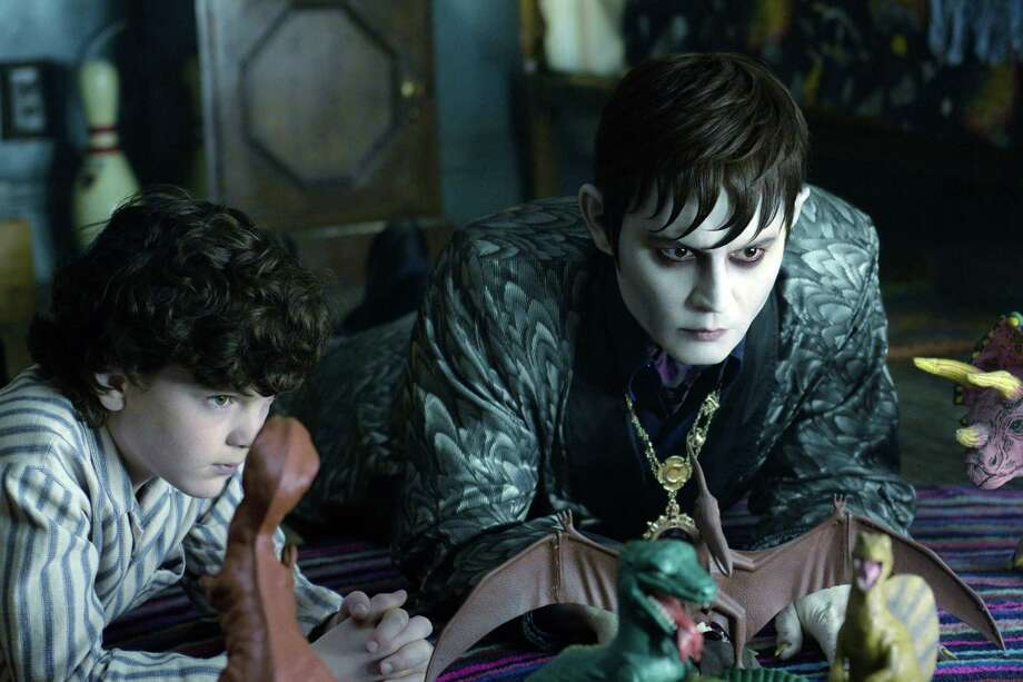 "In this film image released by Warner Bros., Gully McGrath portrays David Collins, left, and Johnny Depp portrays Barnabas Collins in a scene from ""Dark Shadows."" Photo: AP"