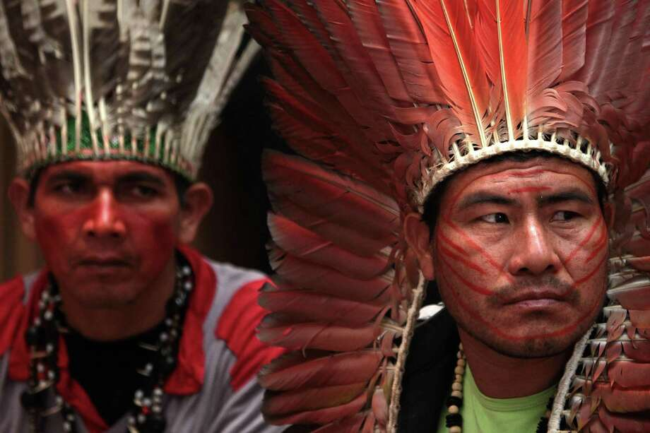 Indians from the Hunikuni tribe protest slave labor outside the Chamber of Deputies in Brasilia, Brazil, Tuesday, May 8, 2012. Brazil's lower house is expected to vote on a constitutional amendment that would punish landholders found to be using slave labor. The proposed bill would allow the government to confiscate all property of those found to be using slave labor, among other penalties. (AP Photo/Eraldo Peres) Photo: Eraldo Peres, Associated Press / AP