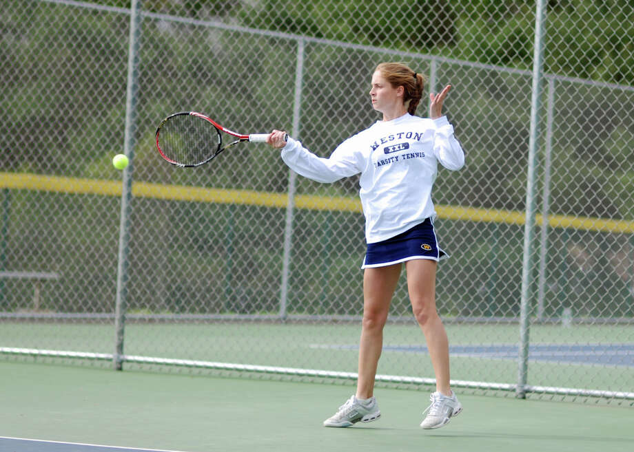 Weston's Kimmy Guerin hits a forehand shot against Newtown Monday. Guerin won 6-1, 6-1 at first singles over Caroline Kelly in the Lady Trojans' 6-1 loss. Photo: Steven Gersh / Contributed Photo