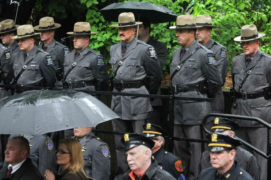 New York state troopers attend the State of New York police officers memorial remembrance ceremony held at the Law Enforcement Memorial at the Empire State Plaza Tuesday, May 8, 2012 in Albany, N.Y. (Lori Van Buren / Times Union) Photo: Lori Van Buren