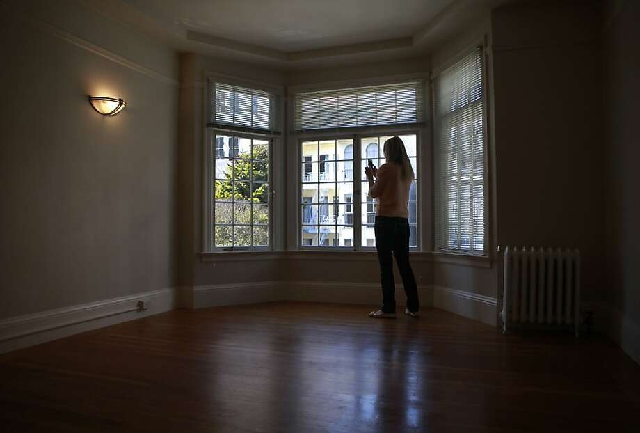Wendy Willbanks takes plenty of photos and videos for her clients at every apartment. Wendy Willbanks started a service called She Moves You, where Wendy scouts apartments on behalf of her clients. With he camera phone in hand, Wendy visits open houses and looks for the best apartments in the city. Photo: Sean Culligan, The Chronicle