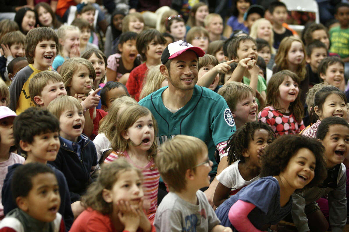 Seattle Mariners player Ichiro Suzuki sits with students during the annual D.R.E.A.M Team Assembly on Tuesday, May 8, 2012 at TOPS at Seward K-8 School in Seattle. The annual event is is part of a program that brings players into schools to talk about the D.R.E.A.M. principles. The principles are