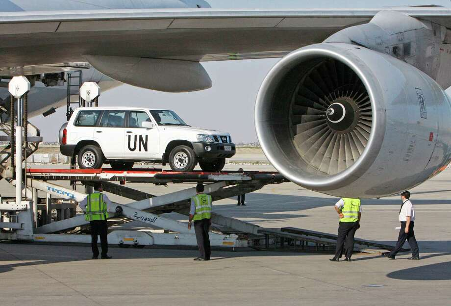 A vehicle for the UN observers is offloaded from a plane at the Damascus airport in Syria, Tuesday, May, 8, 2012. Special envoy Kofi Annan is to brief the U.N. Security Council on Tuesday about the situation in the country, where about 40 U.N. observers are trying to calm the situation. U.N. officials hope to deploy a larger force of up to 300 observers. (AP Photo/Muzaffar Salman) Photo: Muzaffar Salman / AP