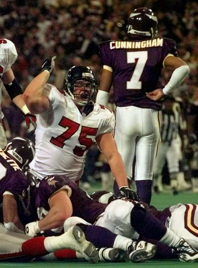 Atlanta Falcons' Shane Dronett (75) celebrates after the Falcons recovered a fumble by Minnesota Vikings quarterback Randall Cunningham in the second quarter of the NFC Championship game on Sunday, Jan. 17, 1999, in Minneapolis. The fumble recovery led to a touchdown pass from Chris Chandler to Terance Mathias.  (AP Photo/Ed Reinke) Photo: ED REINKE, STF / Beaumont