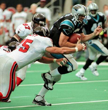 Atlanta Falcons Cornelius Bennett (97) and Shane Dronett (75) get a hold of Carolina Panthers quarterback Kerry Collins (12) in the Georgia Dome in Atlanta Sunday, Oct. 4, 1998. (AP Photo/Alan Mothner) Photo: ALAN MOTHNER, STF / Beaumont