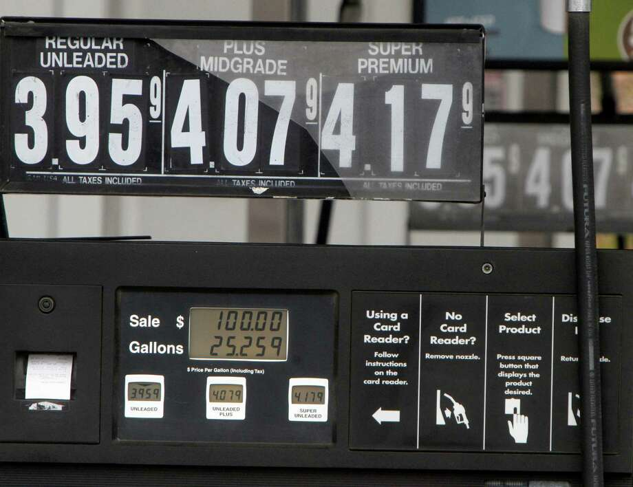 FILE - This April 20, 2012, file photo, shows a gas pump displaying a $100 sale in Barre Vt. The government said Tuesday, May 8, 2012, that gasoline will be cheaper this summer than previously expected thanks to a drop in the price of oil. The Energy Department says drivers should pay an average of $3.79 per gallon at the pump from April through September. (AP Photo/Toby Talbot, File) Photo: Toby Talbot