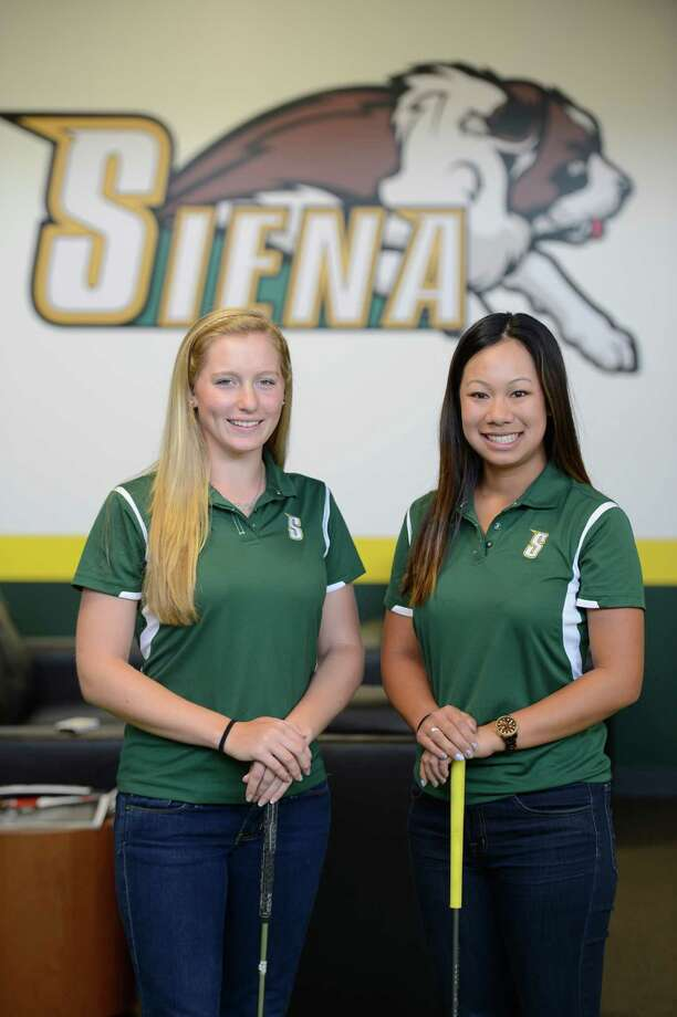 Siena Golf Team members Kylie Strijek, left and Victoria Nguyen at the practice facility on the Siena campus in Loudonville, N.Y. May 7, 2012.  (Skip Dickstein / Times Union) Photo: SKIP DICKSTEIN / 00017582A