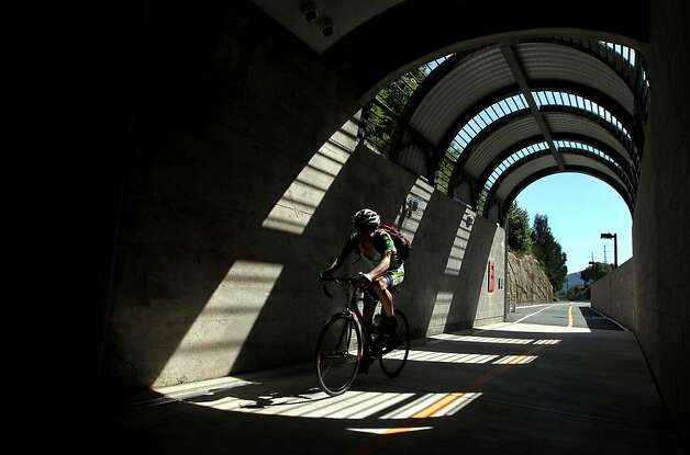 Cyclists use the old railroad tunnel from San Rafael to the Larkspur Calif, Tuesday, May 8, 2012 in Larkspur Calif. Senator, Barbara BoxerÕs conference committee clashed Tuesday with House Republicans over transportation funding Ñ specifically whether programs that help bicyclists and pedestrians such as the old railroad tunnel that used by hundreds in Marin County daily. Photo: Lance Iversen, The Chronicle