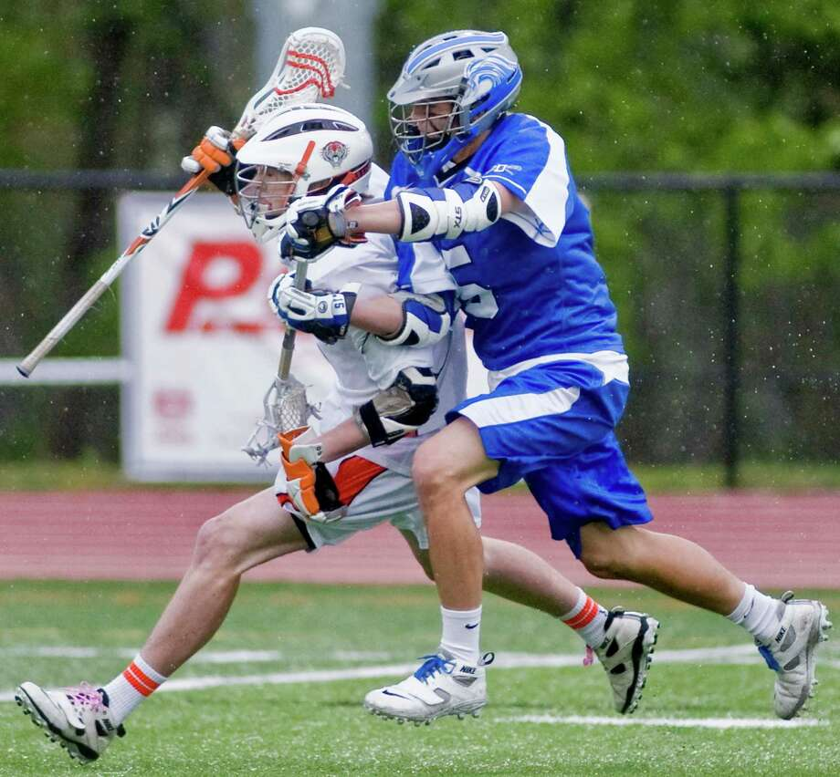 Ridgefield High School's Calvin Dearth and Darien High School's CJ Raia tangle during a lacrosse game at Ridgefield. Tuesday, May 8, 2012 Photo: Scott Mullin / The News-Times Freelance