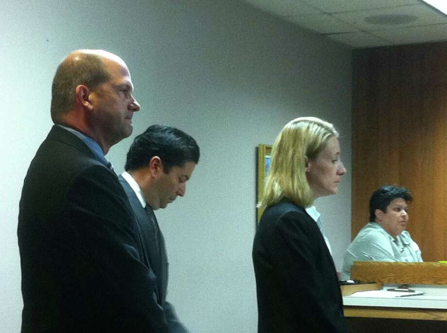 Julie Ann Bronson stands with attorneys Patrick Hancock (far left) and David Christian as an indictment is read against on Tuesday, May 8, 2012, at the outset of her intoxication assault and failure to stop and render aid trial. She pleaded guilty to both charges. Photo: Craig Kapitan, San Antonio Express-News