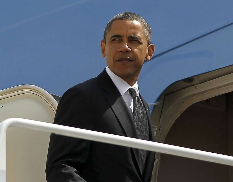 President Barack Obama prepares to board Air Force One before his departure from Andrews Air Force Base, Tuesday, May, 8, 2012. (AP Photo/Pablo Martinez Monsivais) Photo: Pablo Martinez Monsivais, Associated Press