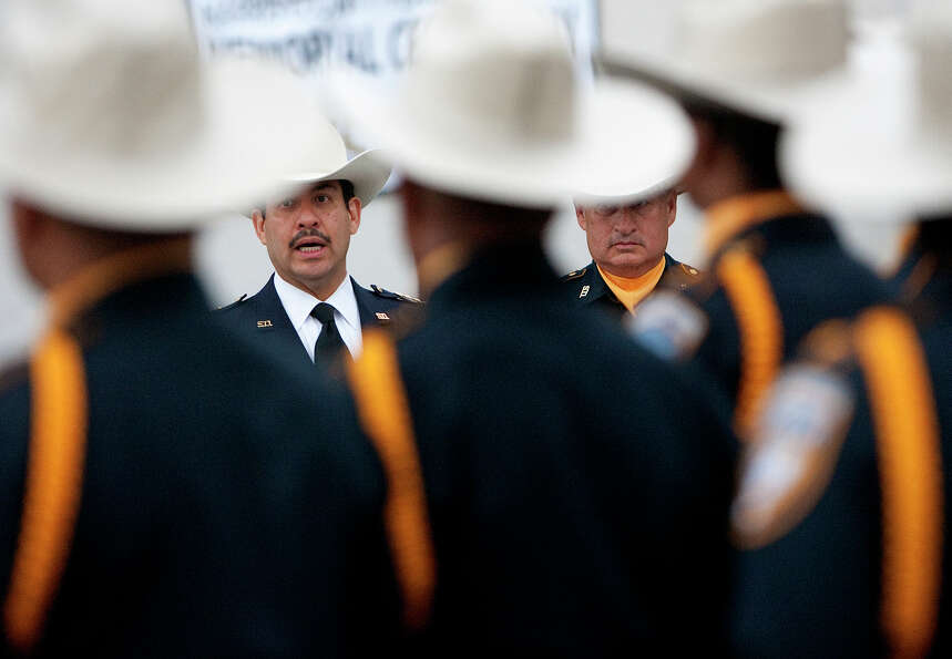 Harris County Sheriff Adrian Garcia, left, stands with Lt. R. Diaz, right, as he address officers be