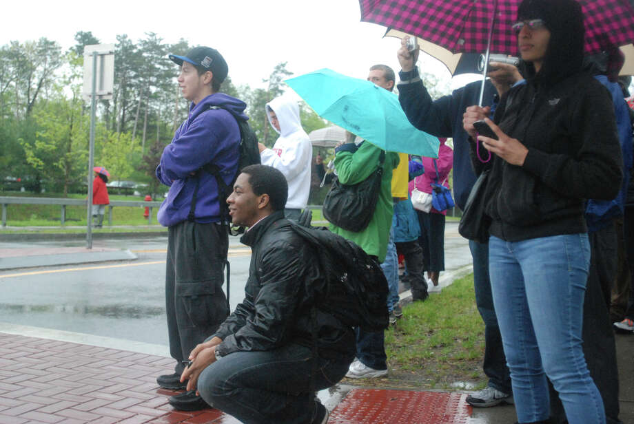 The crowd outside the main entrance to the College of Nanoscale Science and Engineering of the University at Albany watches as President Barack Obama's motorcade slips into another entrance on Tuesday, May 8, 2012. (Yi-Ke Peng / Times Union)