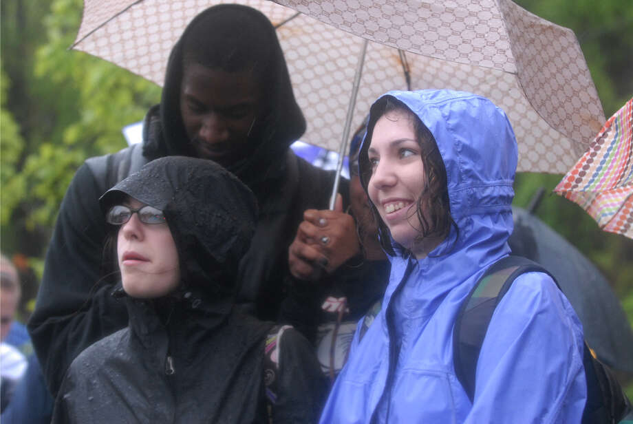 University of Albany students Lexi Reale, left, Rose Avellino, right, and Everol Taylor, back, wait at the main entrance to the College of Nanoscale Science and Engineering of the University at Albany for President Barack Obama's arrival. (Yi-Ke Peng / Times Union)