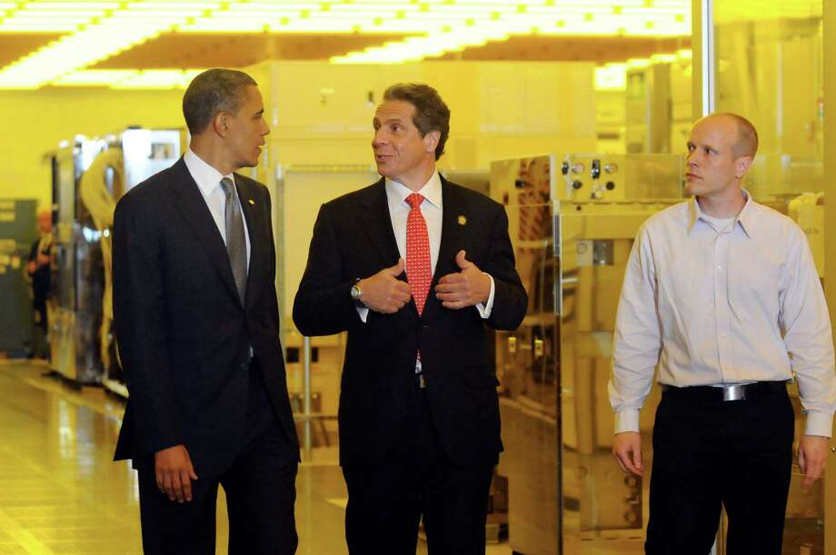 President Barack Obama, left, and Gov. Andrew Cuomo, center, and Chris Borst, right, CNSE assistant vice president for module engineering, tour a clean room on Tuesday, May 8, 2012, at University at Albany College of Nanoscale Science and Engineering in Albany, N.Y. (Cindy Schultz / Times Union) Photo: Cindy Schultz / 00017555B