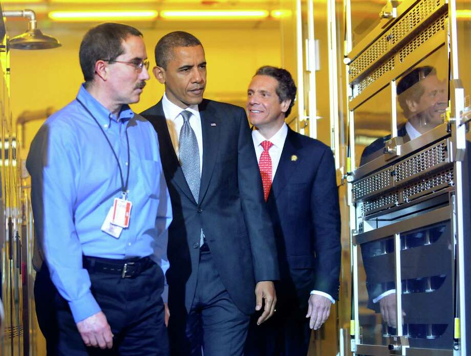 President Barack Obama, center, and Gov. Andrew Cuomo, right, tour a clean room on Tuesday, May 8, 2012, at University at Albany College of Nanoscale Science and Engineering in Albany, N.Y. (Cindy Schultz / Times Union) Photo: Cindy Schultz / 00017555B