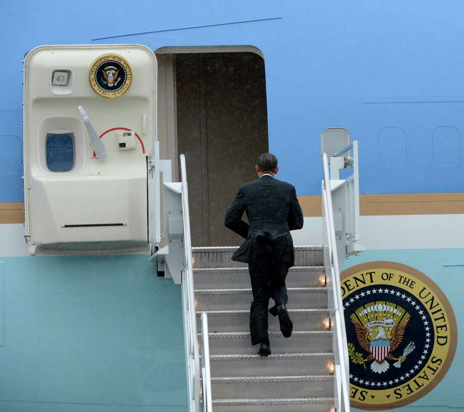 President Barack Obama climbs the stair to Air Force One at the Albany International Airport in Colonie, N.Y. May 8, 2012 after his address at the Nanoscale Science School at the University at Albany.  (Skip Dickstein / Times Union) Photo: SKIP DICKSTEIN / 2012