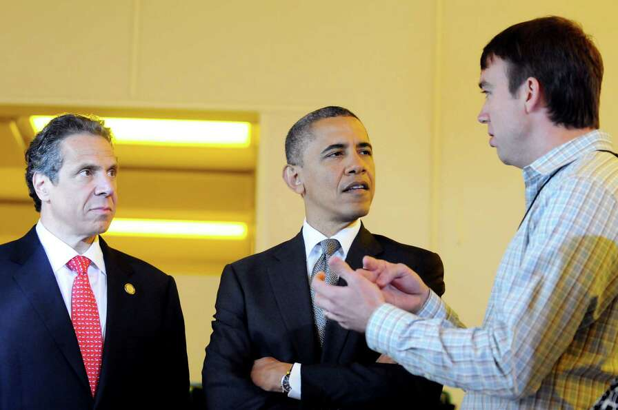 President Barack Obama, center, and Gov. Andrew Cuomo, left,  talk with Martin Rodgers, right, CNSE