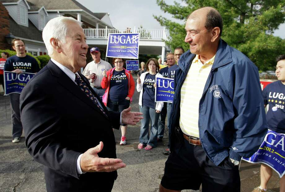 Sen. Richard Lugar talks with Joe Purichia before voting on Tuesday, May 8, 2012, in Greenwood, Ind. Lugar is being challenged by two-term state Treasurer Richard Mourdock. (AP Photo/Darron Cummings) Photo: Darron Cummings