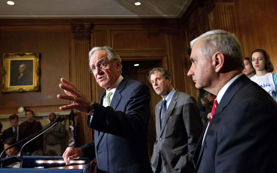 From left, Sen. Tom Harkin, D-Iowa, Sen. Sherrod Brown, D-Ohio, and Sen. Jack Reed, D-R.I., are backed up by students during a news conference on Capitol Hill in Washington, Tuesday, May 8, 2012, as the Senate moved toward a showdown on a Democratic proposal to keep federally subsidized loan interest rates from doubling for millions of college students.  (AP Photo/J. Scott Applewhite) Photo: J. Scott Applewhite