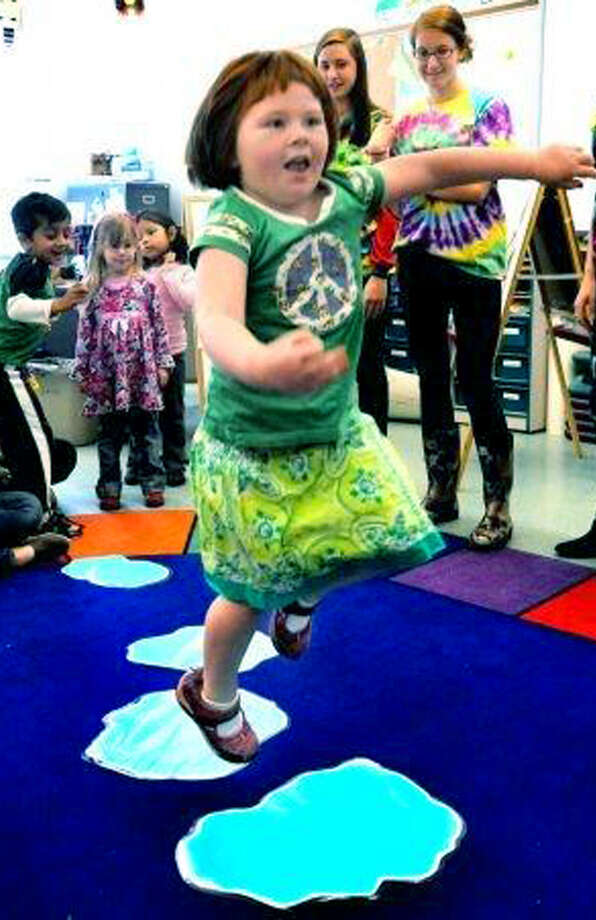 """Emma Kavaneah, 5, jumps """"puddles"""" during a child development class at New Milford High School. April 12, 2012 Photo: Michael Duffy"""