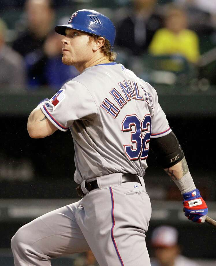 Texas Rangers' Josh Hamilton watches his two-run home run in the third inning of a baseball game against the Baltimore Orioles in Baltimore, Tuesday, May 8, 2012. (AP Photo/Patrick Semansky) Photo: Patrick Semansky