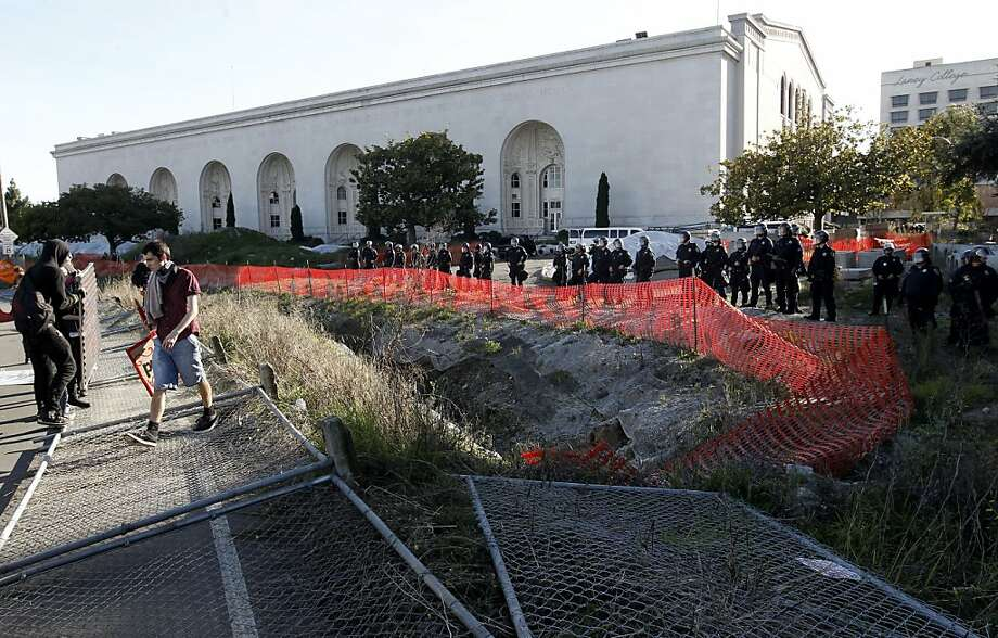"Protesters break down fences in front of the Kaiser Convention Center, as protesters with Occupy Oakland march through the streets of downtown in Oakland, Ca. on Saturday January 28, 2012.  With plans to take over a vacant building, Occupy Oakland spokesman Leo Ritz-Barr said the action ""signals a new direction for the Occupy movement: putting vacant buildings at the service of the community.""Ritz-Barr said there will be a two-day party at the seized building that will be called the ""Oakland Rise Up Festival"" and will include special events, speakers, music and workshops. Photo: Michael Macor, SFC"