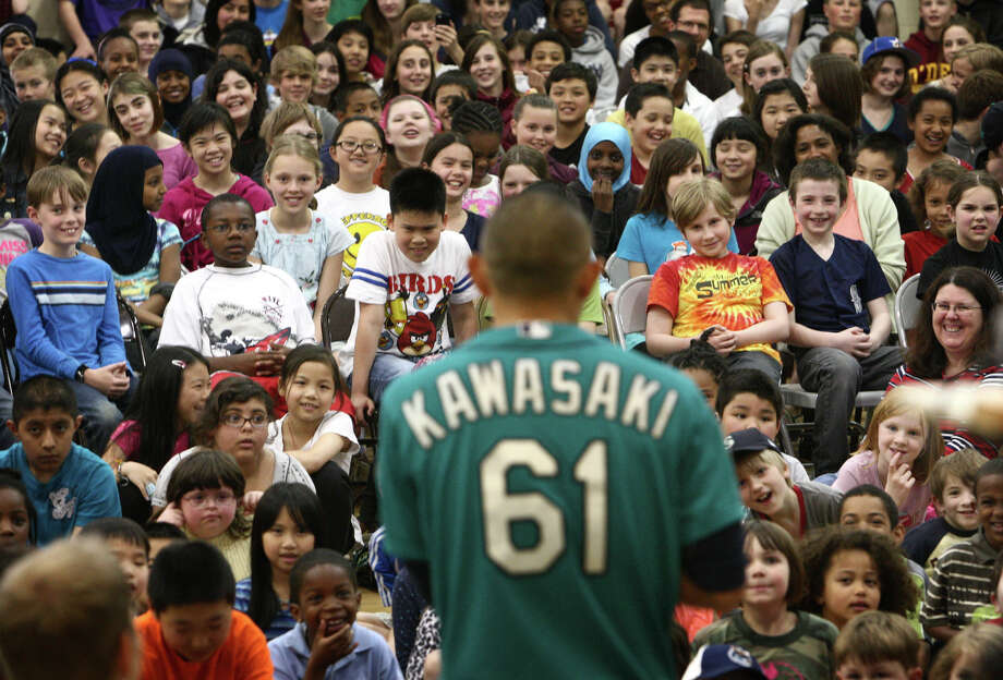 Seattle Mariners player Munenori Kawasaki speaks to students during the annual D.R.E.A.M Team Assembly at TOPS at Seward School. Photo: JOSHUA TRUJILLO / SEATTLEPI.COM