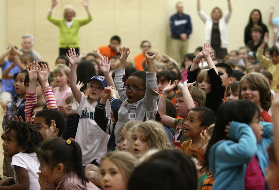 Students cheer for Seattle Mariners players during the annual D.R.E.A.M Team Assembly at TOPS at Seward School. Photo: JOSHUA TRUJILLO / SEATTLEPI.COM