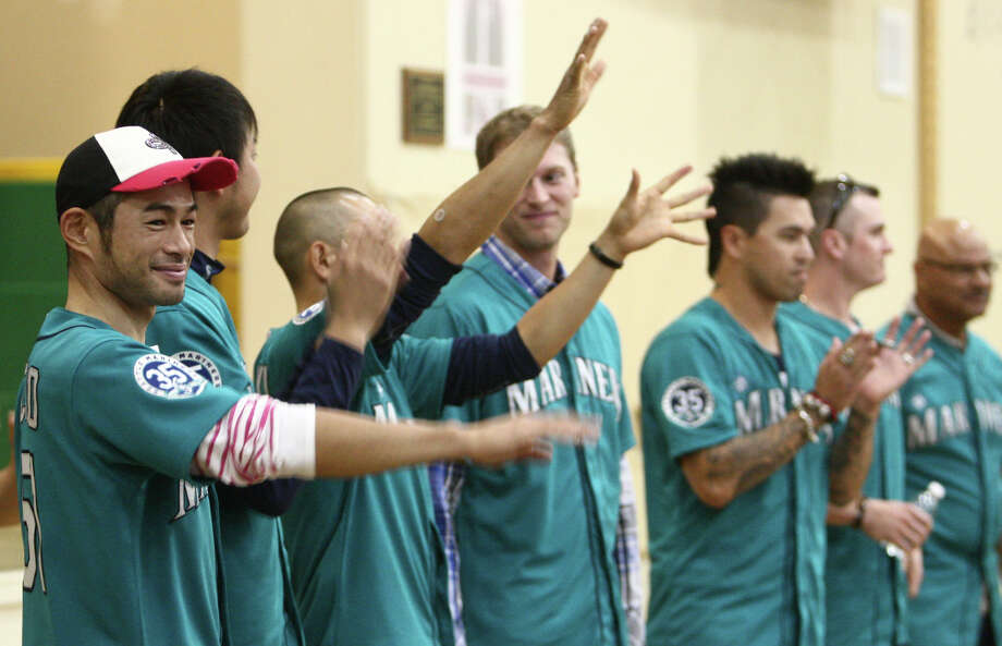 Seattle Mariners players, from left, Ichiro Suzuki, Hisashi Iwakuma, Munenori Kawasaki, Michael Saunders, Brandon League, and  Brendan Ryan are presented in front of students. Photo: JOSHUA TRUJILLO / SEATTLEPI.COM