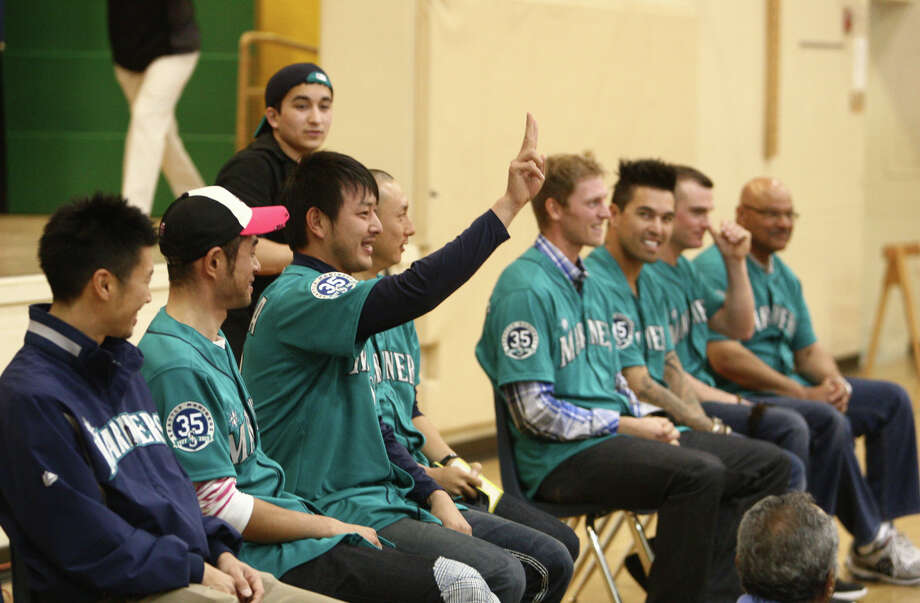 Seattle Mariners players, second from left, Ichiro Suzuki, Hisashi Iwakuma, Munenori Kawasaki, Michael Saunders, Brandon League, and Brendan Ryan speak in front of students. Photo: JOSHUA TRUJILLO / SEATTLEPI.COM