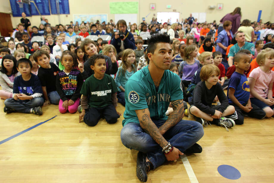 Seattle Mariners player Brandon League sits with students during the annual D.R.E.A.M Team Assembly. Photo: JOSHUA TRUJILLO / SEATTLEPI.COM