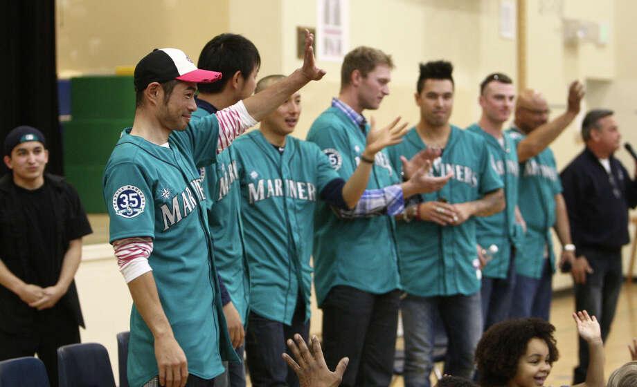 Seattle Mariners players, from left, Ichiro Suzuki, Hisashi Iwakuma, Munenori Kawasaki, Michael Saunders, Brandon League, and  Brendan Ryan are presented in front of students. Photo: JOSHUA TRUJILLO / SEATTLEPI.COM