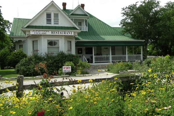 """The Victorian house that's now home to Junction House restaurant in Kingsland, Texas, was featured in """"Texas Chainsaw Massacre"""" before it was moved from Williamson County to its present location on the grounds of Antlers Hotel and Railyard."""