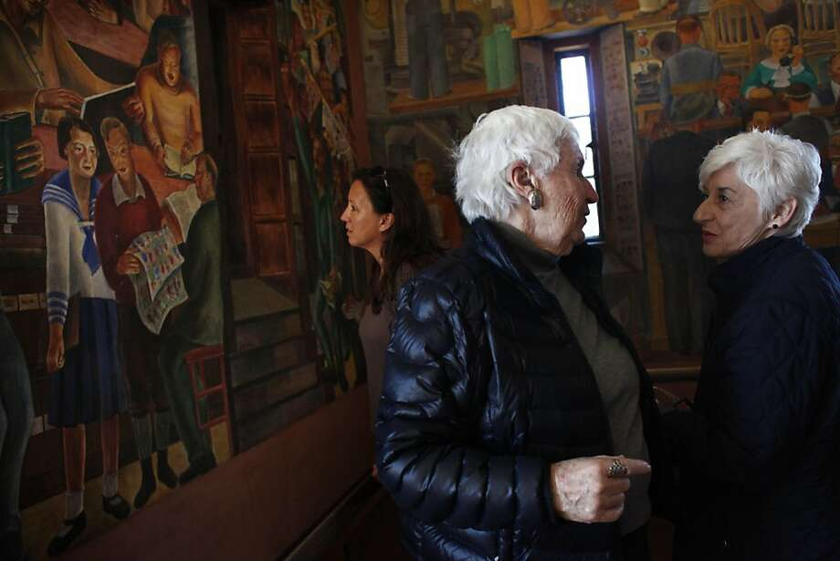 Ruth Gottstein (l to r), daughter of Coit Tower artist Bernard Zakheim; and Gayle Leyton of San Francisco talk next to the mural by her father Bernard Zakheim (left) where Gottstein is depicted in the mural as a little girl (seen at left in mural) on Tuesday, May 8, 2012 in San Francisco, Calif.  Coit Tower supporters joined family members of the original mural artists at Coit Tower to officially launch the campaign for Proposition B, a measure on the June 15th San Francisco ballot aimed at preserving Coit Tower, on Tuesday, May 8, 2012 in San Francisco, Calif. Photo: Lea Suzuki, The Chronicle
