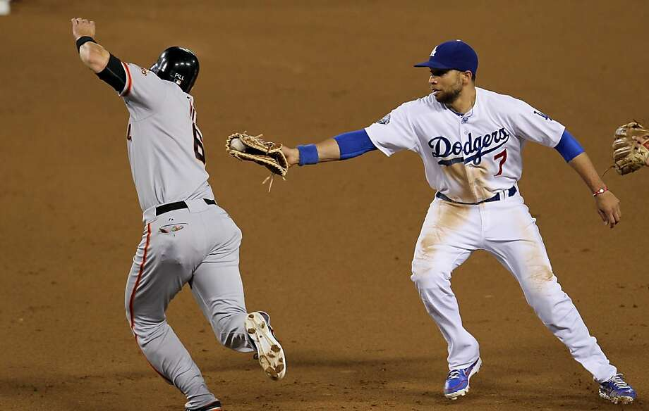 LOS ANGELES, CA - MAY 08:   First baseman James Loney #7 of the Los Angeles Dodgers tags out Brett Pill #6 of the San Francisco Giants before stepping on first for a force out and an unassisted double play on May 8, 2012 at Dodger Stadium in Los Angeles, California.  .  (Photo by Stephen Dunn/Getty Images) Photo: Stephen Dunn, Getty Images