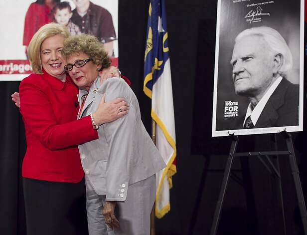 Mary Frances Forrester, the wife of the late N.C. State Sen. James Forrester, right, embraces Tami Fitzgerald from Vote For Marriage NC as they celebrate the passage of Amendment One during an election night party Tuesday May 8, 2012 in Raleigh, N.C. Senator Forrester was the person who proposed Amendment One before his death. North Carolina voters approved the constitutional amendment Tuesday defining marriage solely as a union between a man and a woman, becoming the latest state to effectively slam the door shut on same-sex marriages. (AP Photo/The News & Observer, Robert Willett) MANDATORY CREDIT Photo: Robert Willett, Associated Press