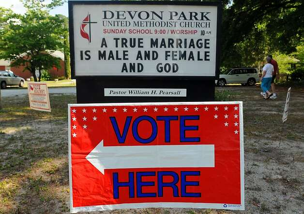 A sign displays a message opposed to gay marriage in front of the Devon Park United Methodist Church polling site on Tuesday, May 8, 2012, in Wilmington, N.C. North Carolina could be the next state to pass a constitutional amendment defining marriage as solely between a man and a woman. Voters are casting their ballots Tuesday. (AP Photo/The Star-News, Ken Blevins) Photo: Ken Blevins, Associated Press